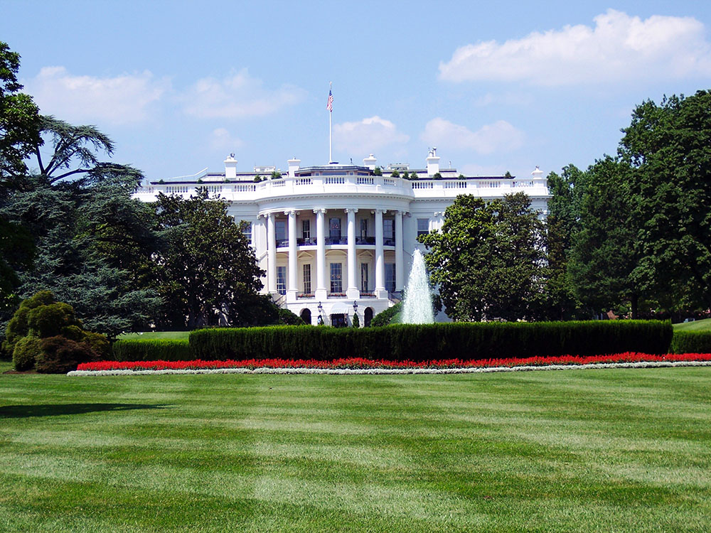 A photo shows the exterior of the United States White House.