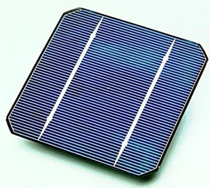 There is an image of a blue solar cell. The solar cell is square, with diagonal notches removed from each corner.