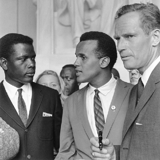 A photo of three civil rights activists, from left to right, Sidney Poitier, Harry Belafonte, and Charlton Heston.