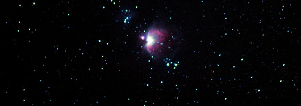 A photo shows a star system, the Orion Nebula.