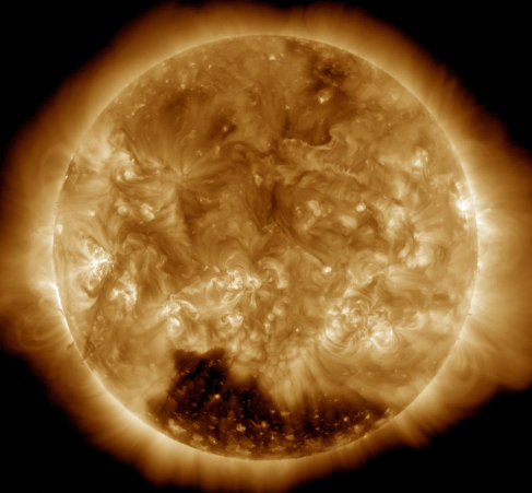 An image of a coronal hole, a large dark splotch at the bottom of the sun.