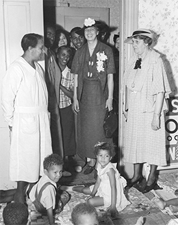A photograph shows Eleanor Roosevelt visiting a WPA nursery school, surrounded by a small group of adults and several children.