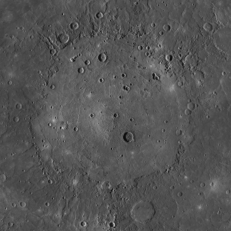 Photograph of the Caloris Basin on Mercury. The circular, flat plain of Caloris Basin is surrounded by cratered highlands and rough terrain. A few impact craters are scattered over the smooth surface of the basin.