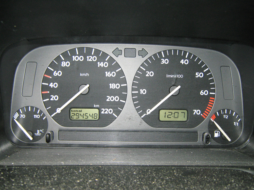 This photograph shows the instruments on a gray Volkswagen Vento dashboard, including the speedometer, odometer, and fuel and temperature gauges, showing some readings.