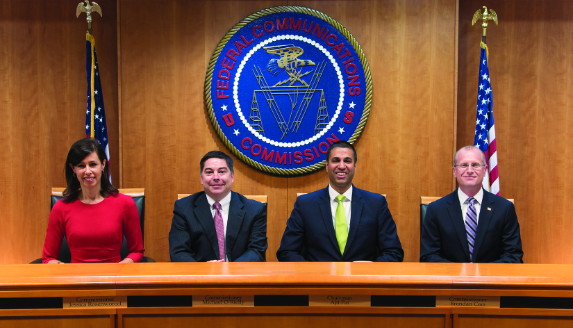 A photograph shows the commissioners of the FCC: Jessica Rosenworcel, Michael O'Rilley, Ajit Pai, and Brendan Carr.