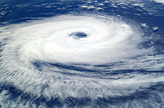 A photograph of a hurricane, showing the rotation around its eye.