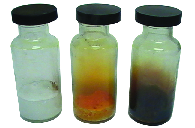 Three sealed glass vials are shown. The left vial contains a pale yellow gas and a colorless liquid, the middle contains an orange gas and solid, and the right contains a purple gas and solid.