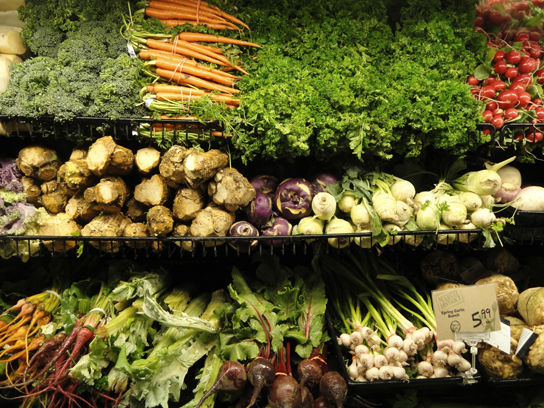 Photos shows a variety of fresh vegetables in a grocery store.