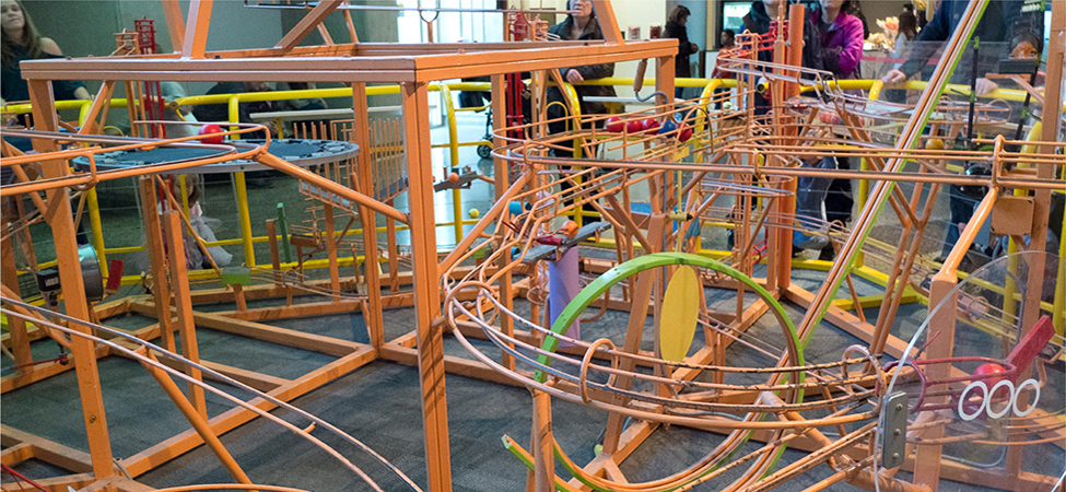 A photograph of a ball machine, consisting of a complex set of tracks.
