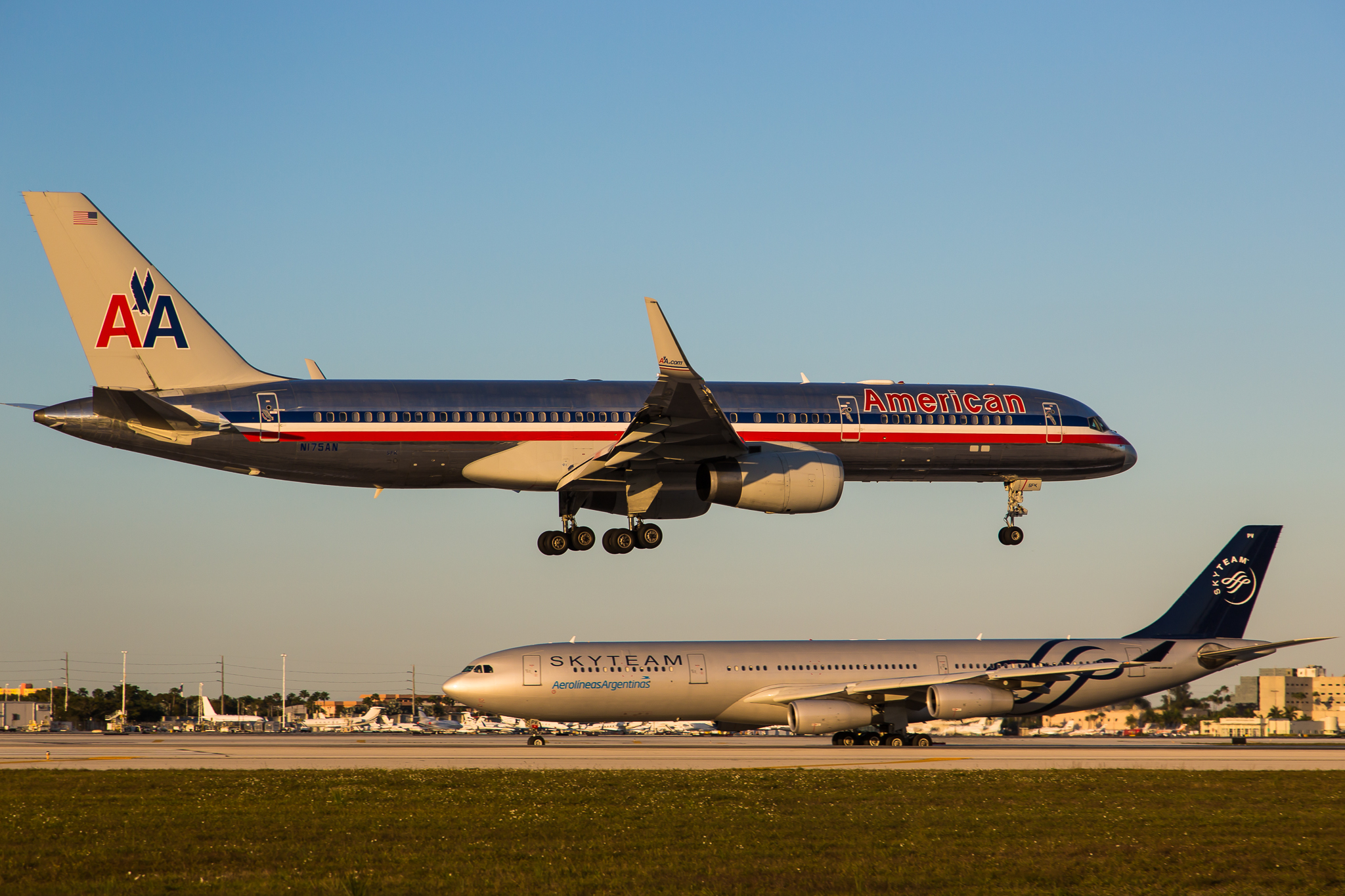 An American Airlines plane is landing at an airport.