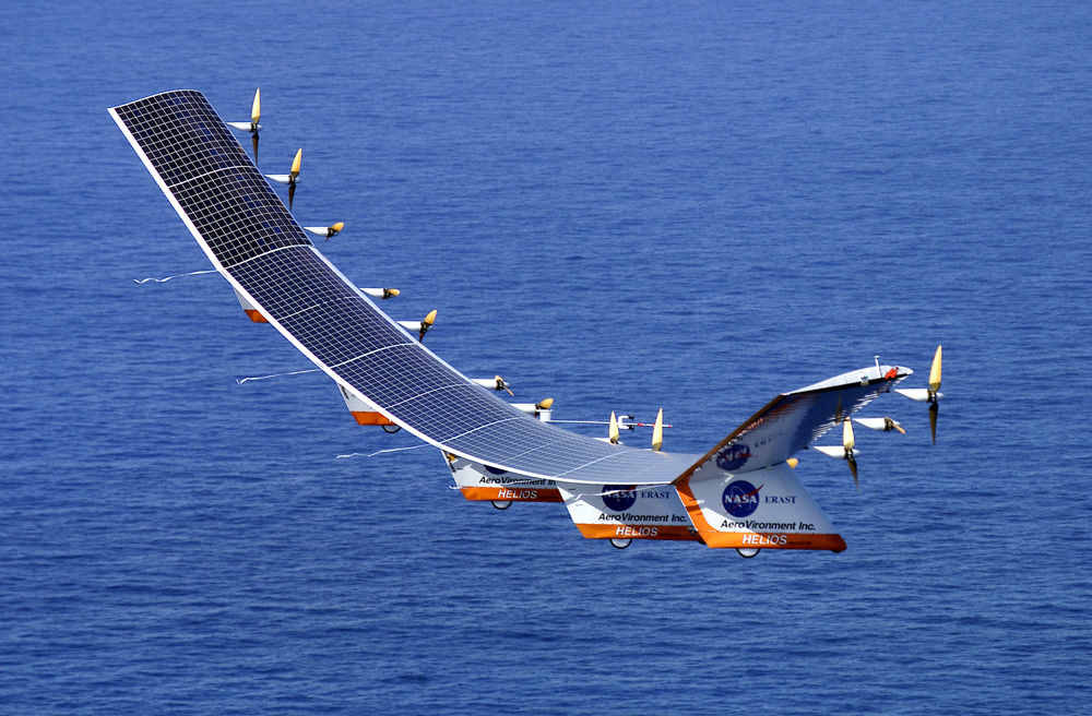 A solar-powered aircraft flying over the sea. Solar cells are on the upper surface of the wings, where they are exposed to sunlight.