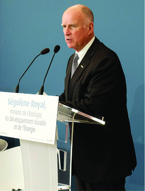 A photograph of Jerry Brown speaking from a podium.